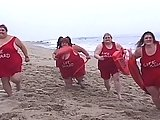 Four Fat Lifeguards Frolic On The Beach